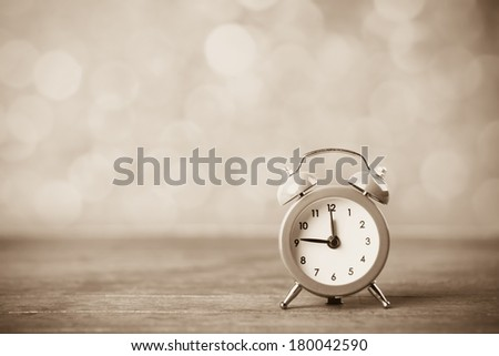 Retro alarm clock. Photo in retro color image style - stock photo