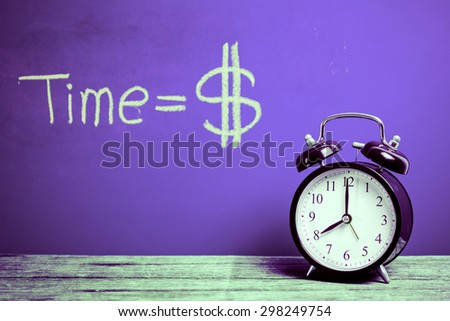Retro alarm clock with colorful wood wall background  - stock photo