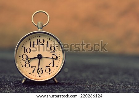 Retro alarm clock with retro vintage efect - stock photo