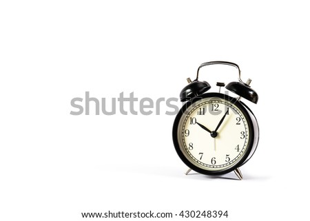 Retro alarm clock with Ten o'clock and five minute on white background. - stock photo
