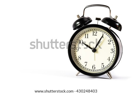 Retro alarm clock with Ten o'clock and five minute on white background .