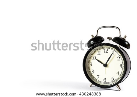 Retro alarm clock with Ten o'clock and five minute on white background.Clock concept.  - stock photo