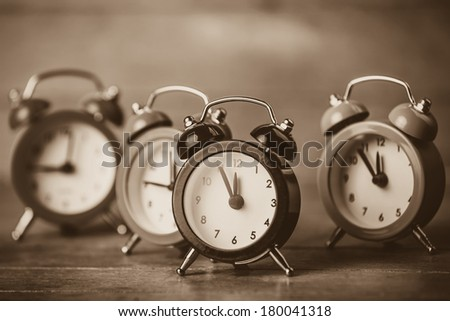Retro alarm clocks on a table. Photo in retro color image style