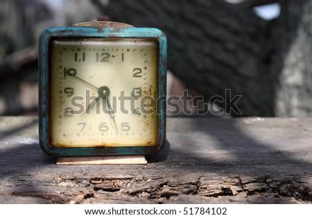 Retro alarm on wooden board - stock photo