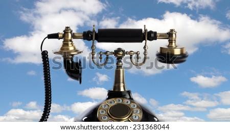 Retro and elegant telephone on the heaven - stock photo