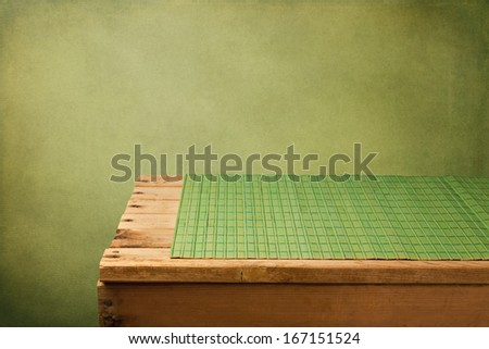 Retro background with empty wooden table and place mat - stock photo