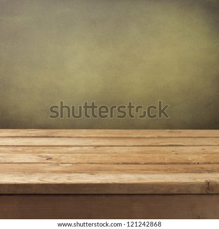 Retro background with wooden table and grunge wall - stock photo