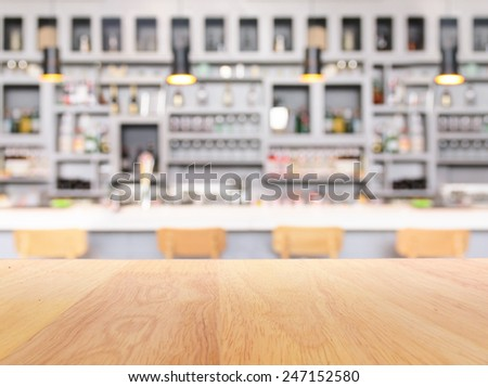 Retro bar counter with bottles in blurred background - stock photo