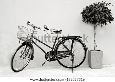 Retro bicycle with basket in black and white