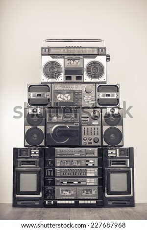 Retro big radio cassette and disk recorders from 80s. Vintage old style sepia greyscale photo