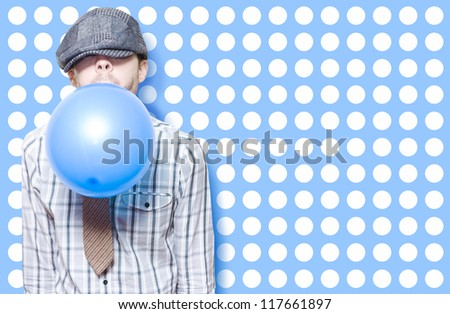 Retro Birthday Kid Blowing Up A Blue Party Balloon On Cute Polka Dot Card Background