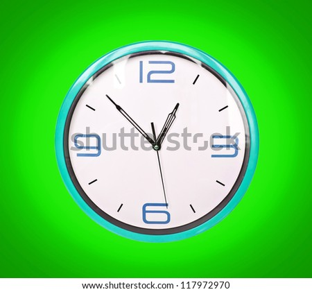 Retro blue clock on green background