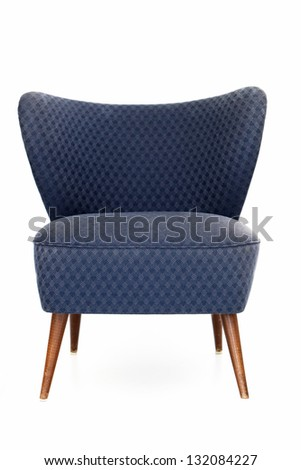 Retro Blue Upholstered Comfy Chair With Patterned Fabric And A Curved Back  Isolated On White