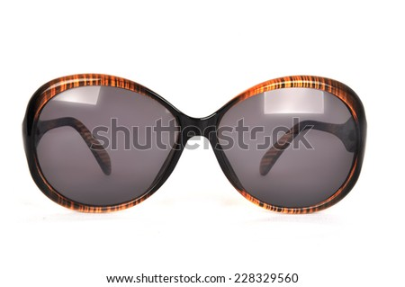 retro brown sunglasses on a white background - stock photo