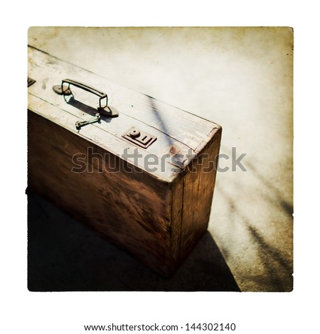 Retro brown wooden suitcase - stock photo