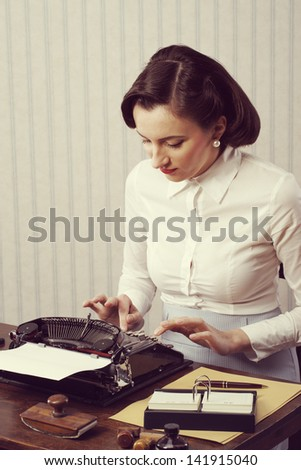 Retro business woman typing in her office