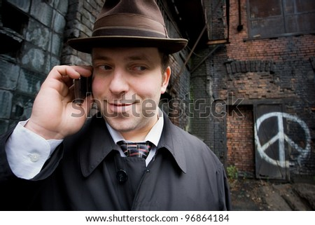 retro businessman said by telephone - stock photo
