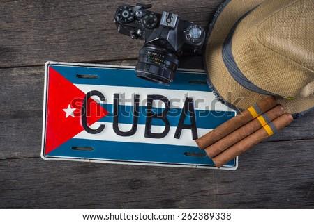Retro camera and Cuban flag and cigars - stock photo