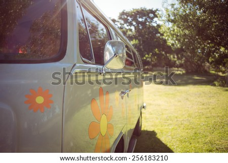 Retro camper van in a field on a summers day - stock photo