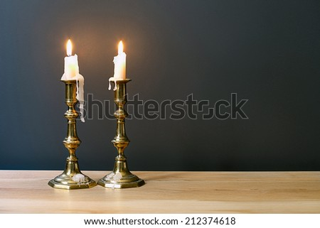 Retro Candelabra With Burning Candles In Minimalist Room Interior 	  - stock photo