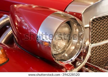 Retro car headlight - stock photo