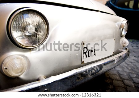 Retro car in the street of rome - stock photo
