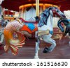 Retro Carousel with colorful horse and lights  - stock photo