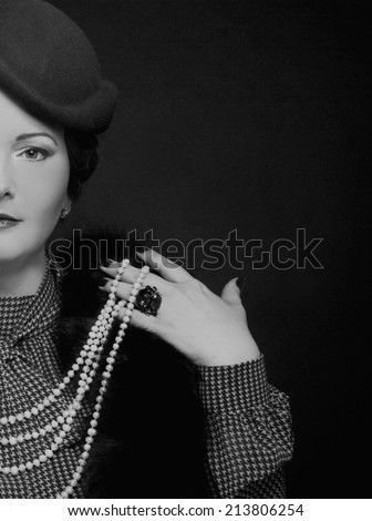 Retro. Charming woman in elegant retro image. - stock photo
