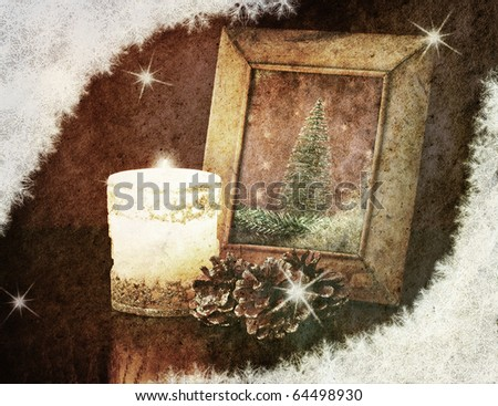 retro christmas card, vintage photo-frame on a table at candlelight - stock photo
