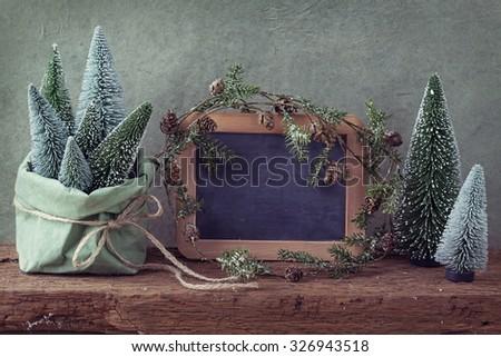 Retro christmas decoration and wooden empty blackboard - stock photo