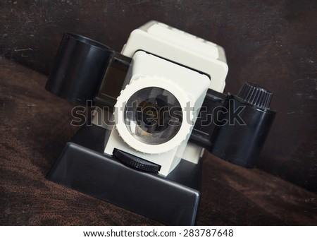 Retro cine-projector on the dark background. Vintage still life.  - stock photo