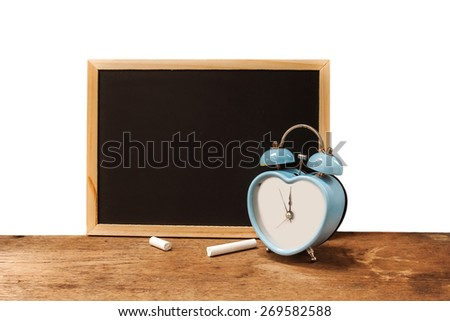 retro clock and chalkboard on wooden floor isolated on white background.