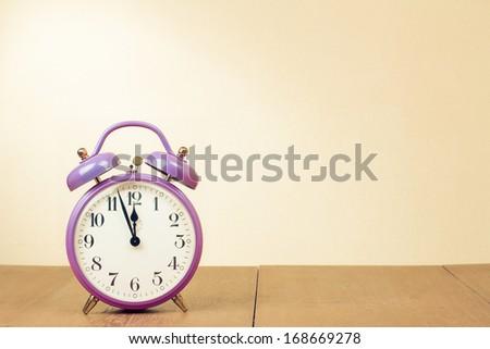Retro clock with five minutes to twelve o'clock - stock photo