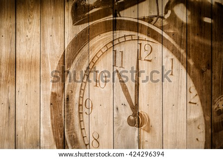 retro closeup clock face on wood background selective focus at number 11 o'clock.