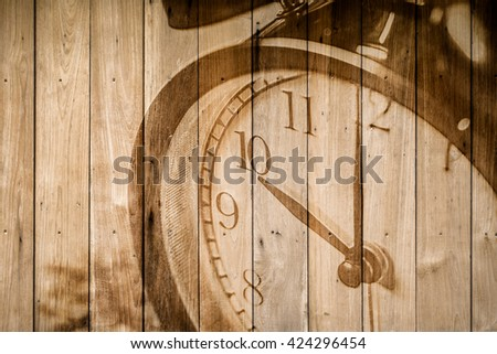 retro closeup clock face on wood background selective focus at number 10 o'clock. - stock photo