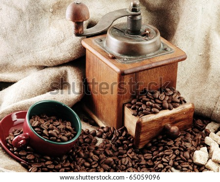 retro coffee grinder with cup and bag - stock photo