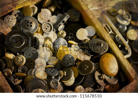 retro collection of vintage buttons in old wooden box with grunge texture - stock photo