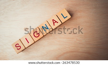 Retro color block of alphabet letters on wooden surface. Concept of retro and common marketing business terms. Slightly defocused and close-up shot. Copy space.