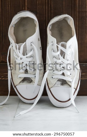Retro color sneakers left on wooden floor