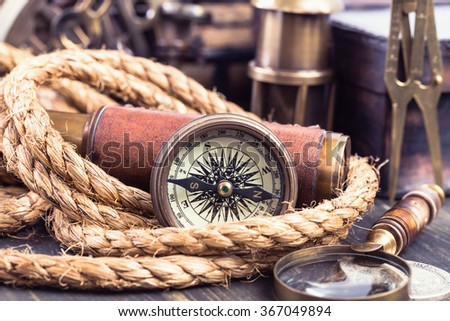 Retro compass and various marine accessories. Closeup