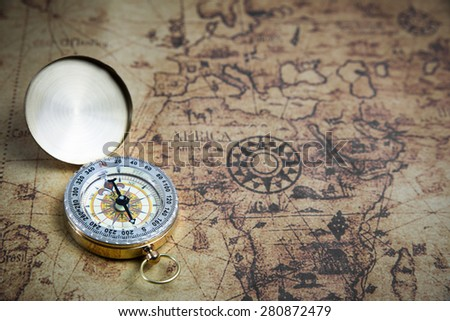 Retro compass on ancient world map stock photo royalty free retro compass on ancient world map vintage style gumiabroncs Gallery