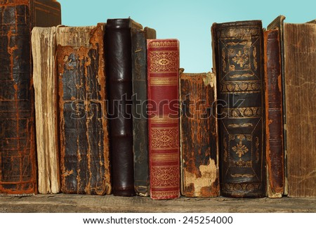 Retro composition with books on turquoise background  - stock photo