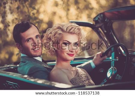 Retro couple in convertible - stock photo