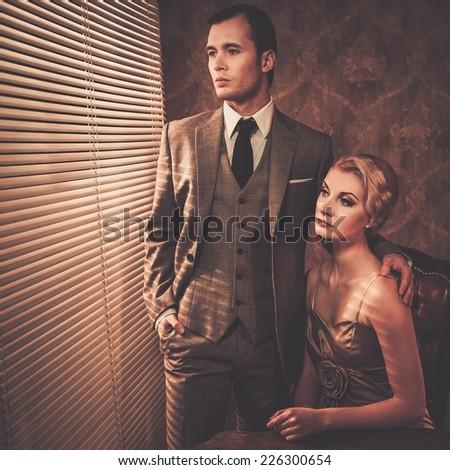 Retro couple near a window - stock photo