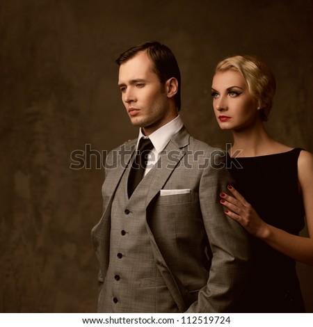 Retro couple on grey background - stock photo