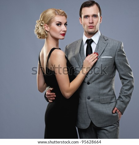 Retro couple on grey background. - stock photo