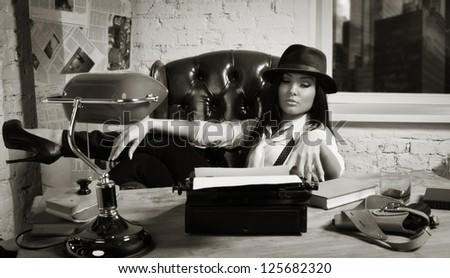 Retro detective girl sits at a table in the agency