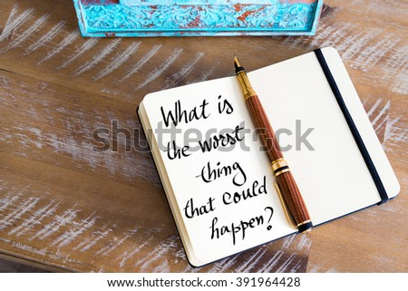 Retro effect and toned image of a fountain pen on a notebook. Handwritten text What Is The Worst Thing That Could Happen ? as business concept image - stock photo