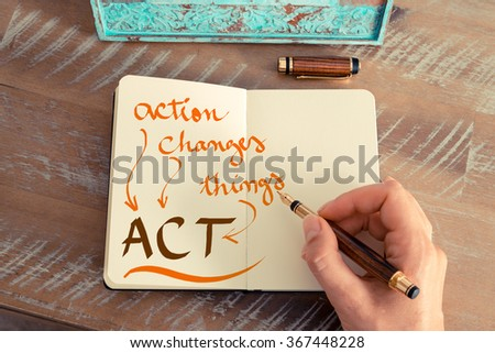 Retro effect and toned image of a woman hand writing a note with a fountain pen on a notebook. Handwritten text ACT ACTION CHANGES THINGS, business success concept - stock photo