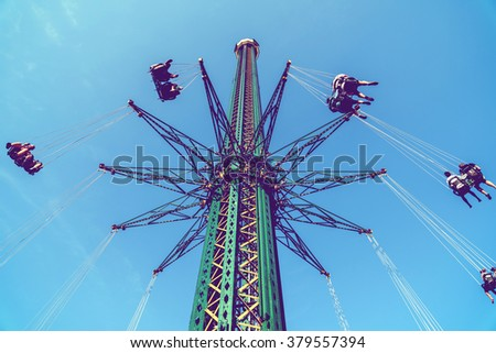 Retro Effect Of Carousel Ride At Amusement Park - stock photo